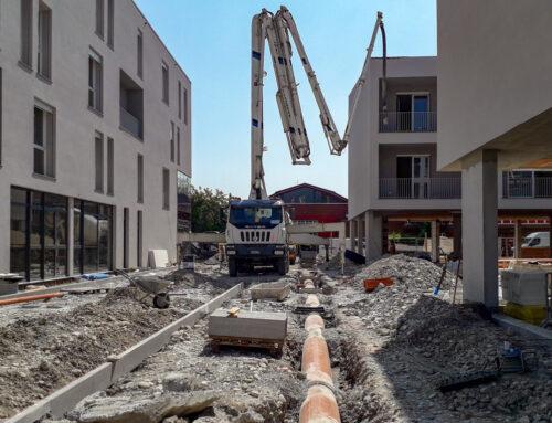 Complesso residenziale-commerciale: sistema fognario e finiture